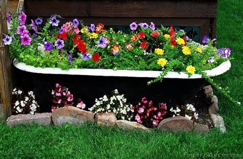 what to do with an old bathtub bathtub turned into a planter want to do this with our old tub up against the garage