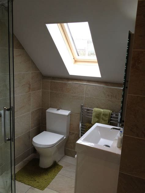 a loft conversion bathroom featuring s embrace
