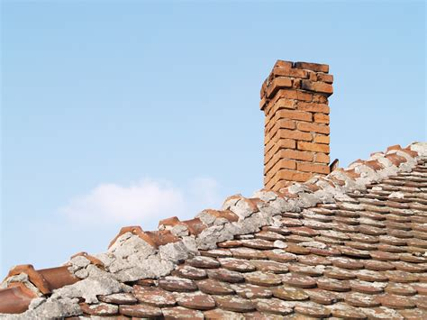 With Chimney how to tell if your chimney or fireplace needs repaired