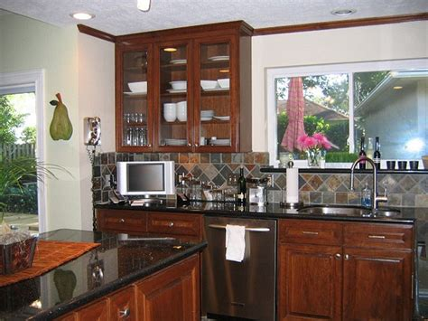 black stainless appliances with cherry cabinets kitchen black galaxy granite cherry cabinets slate tile