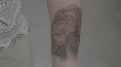 tattoo fixers e4 gallery man has huge monkey face tattooed on his arm to cover up