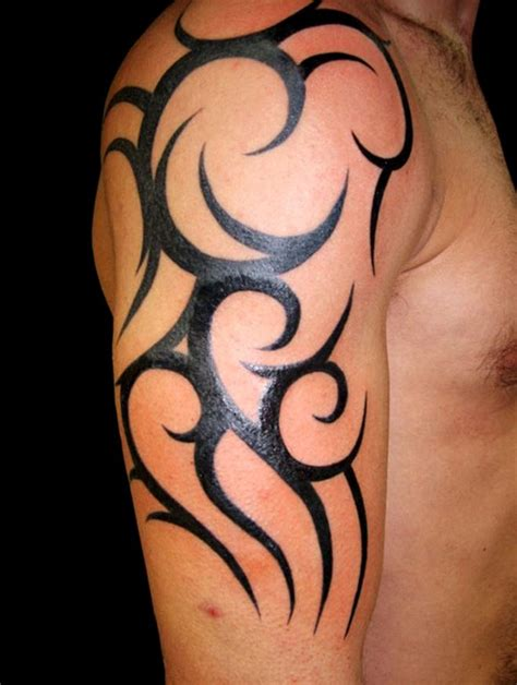 tribal tattoos for men shoulder and arm 52 most eye catching tribal tattoos