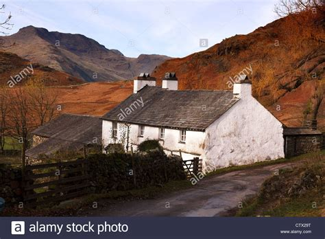 cottage in the mountains white farm cottage quot blea tarn house quot with lakeland mountains beyond stock photo royalty free