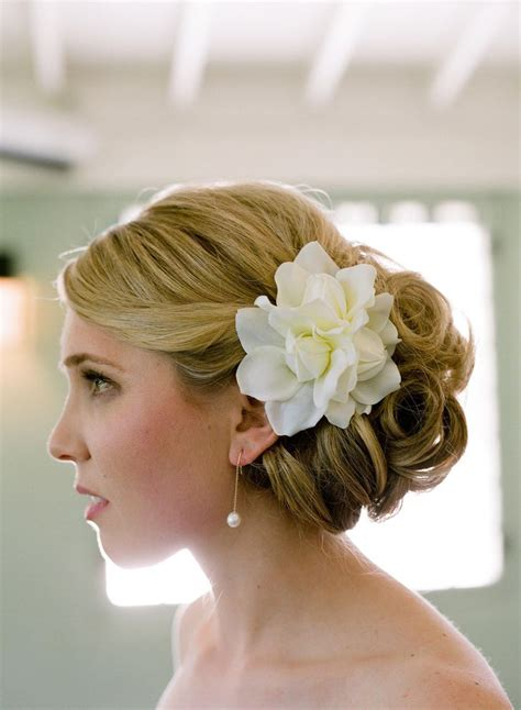 bridal hairstyles low bun with flowers classic bridal updo
