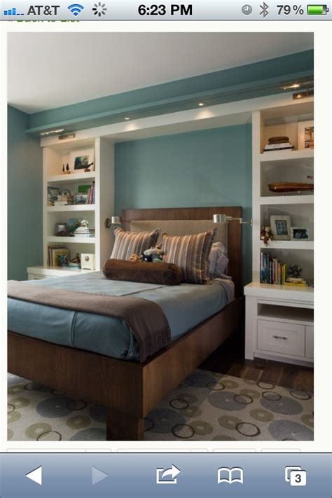 built in bedroom storage a tale of two cities pinterest blue bedroom walls with built in shelves around bed