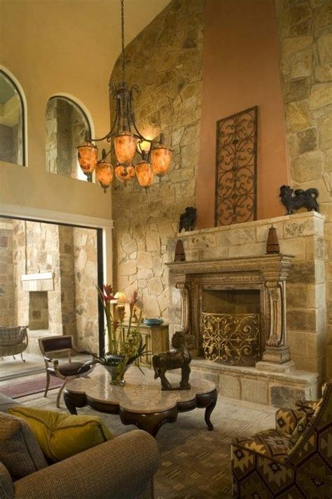 tuscan living room with stone fireplace and note the pin by paula mollet murphy on virtual tuscan home