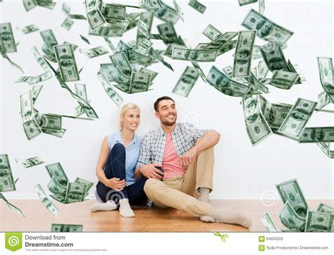 Dreams About Winning Money - happy couple at home over dollar money falling stock