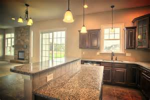 Granite Kitchen Islands With Breakfast Bar The Large Open Kitchen With Adjoining Breakfast Area Includes An Island With A Raised Bar Top