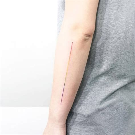minimalist tattoo artists in london tiny tattoo idea rainbow line spectrum tattoo on the