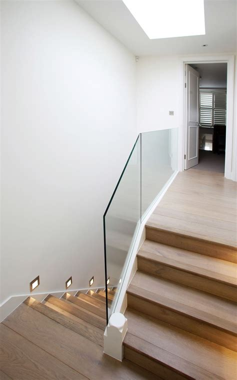 glass stair banister parsons green terraced house london minimal modern stair