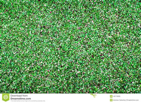 colored gravel a background of pea gravel coloured green stock image