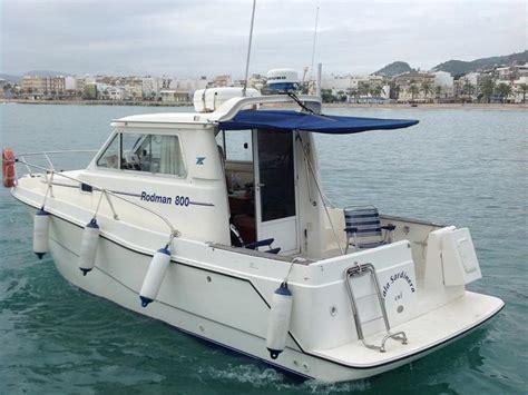 un barco pesquero recolecta 800 rodman 800 en cn cambrils embarcaciones cabinadas de