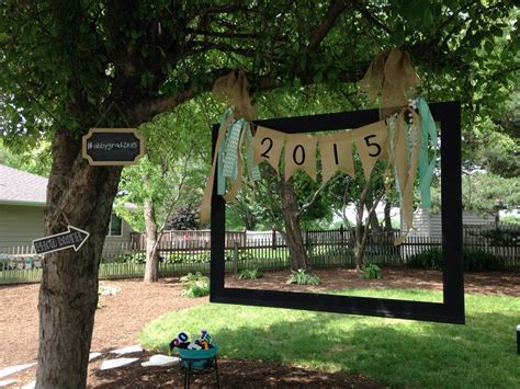 Homemade photo booth. Old picture frame hung with burlap