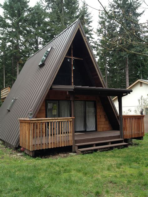 metal cabins cabin roof roof shingles of a log cabin stock photo 538986