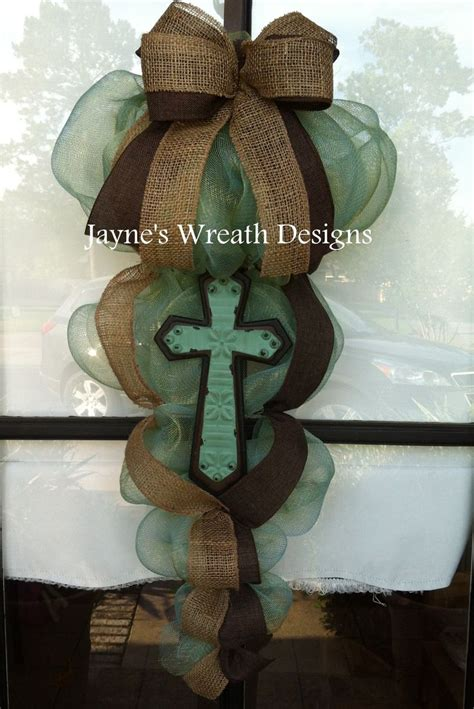 cross door swagswreaths  burlap ribbon jaynes wreath