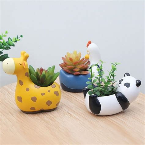 Animal Flower Pot Penguin it s a zoo in here animal planters jumping daisies