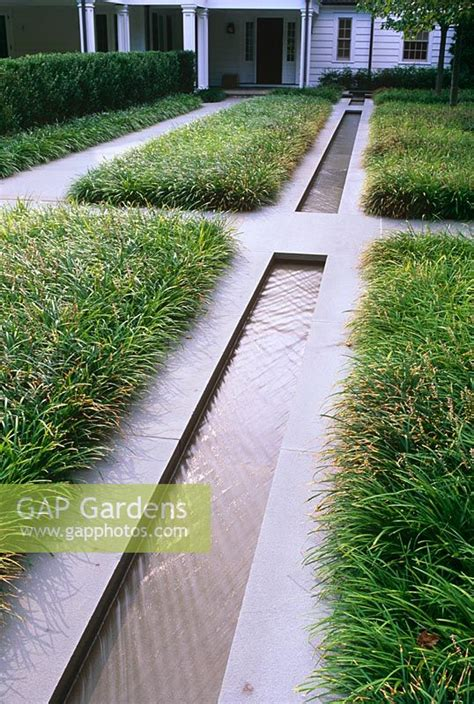 gap gardens contemporary water rill with grasses paths and house in background the odrich