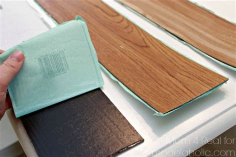 How To Install Peel And Stick Vinyl Plank Flooring by Remodelaholic Diy Plank Backsplash Using Peel And Stick