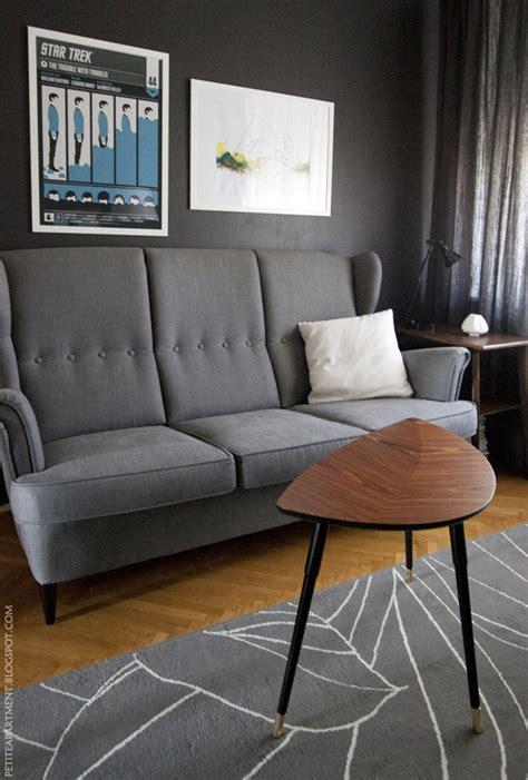ikea strandmon sofa dark grey wall in the living room petite apartment