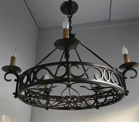 large arts  crafts wrought iron chandelier  dining