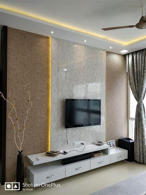 acrylic finish tv unit highlighted  cove lighting