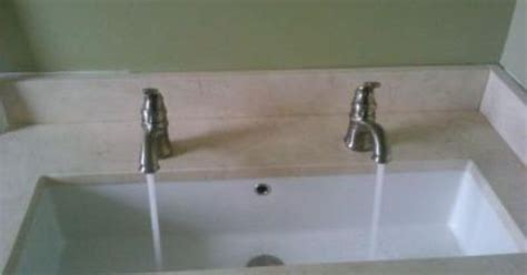 long bathroom sink with two faucets scarabeo undercounter 34 quot trough sink with dual faucets