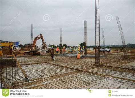 Ground Floor Industries by A Of Construction Workers Floor Slab