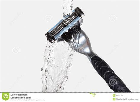 water razor razor up with water splash royalty free stock