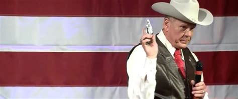 roy moore gun ala senate candidate pulls out his gun during caign