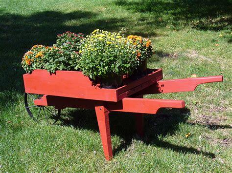 Ornamental Wheelbarrow Planters by Decorative Wheelbarrow Plans Diy Free Wooden