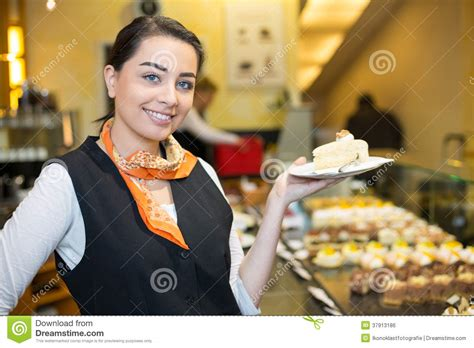 waitress presenting cake in cafe or confectionery stock photo image 37913186