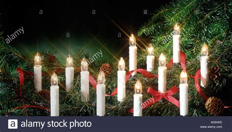electric candles in christmas tree stock photo royalty