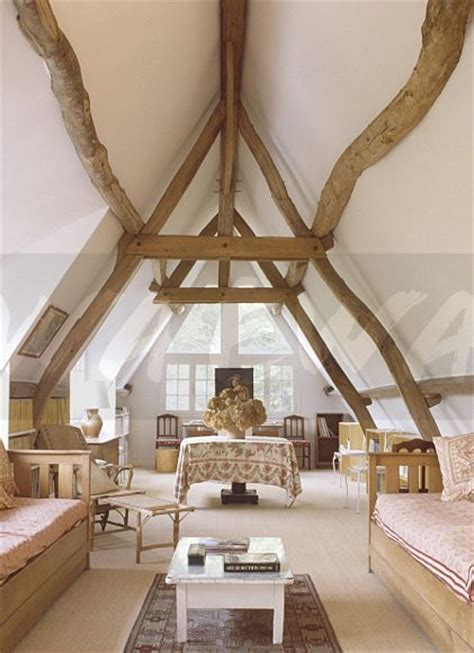 Lowering Ceiling For Loft Conversion by Image Rustic Wooden Beams On Apex Ceiling In Country Loft