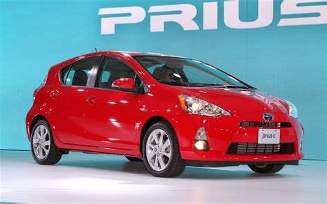 red toyota 2013 toyota prius c front three quarter red photo 18