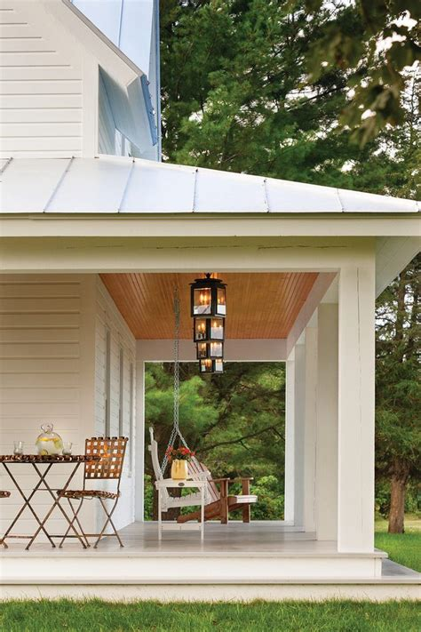 metal roof ceiling porch farmhouse with wraparound porch