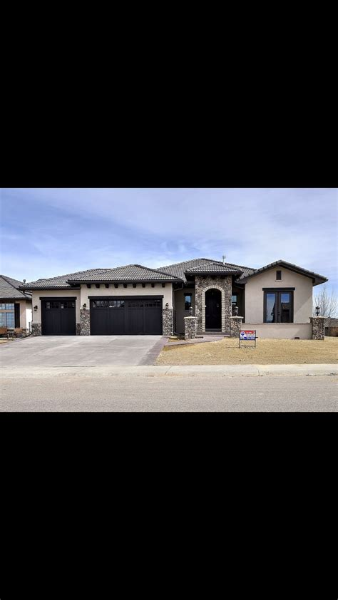 white ranch house with black garage door ranch with black garage doors house