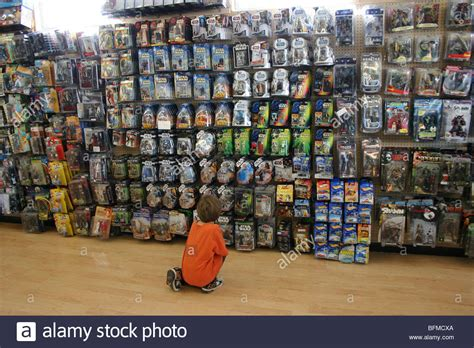figure store child looking at assorted figure toys at a