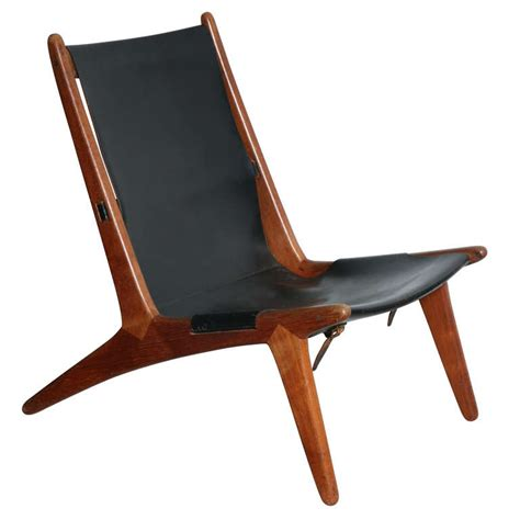 teak sling chair teak and leather sling back lounge chair by kristiansson