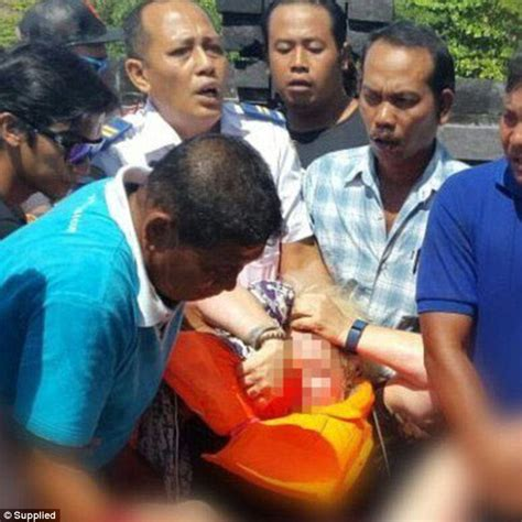 bali ferry explosion kills  foreign tourists  injures
