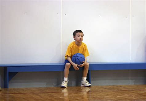 kid on bench performance anxiety in children s sports