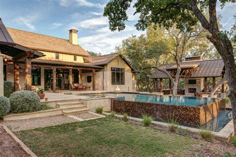 country style architecture hill country farmhouse farmhouse pool by