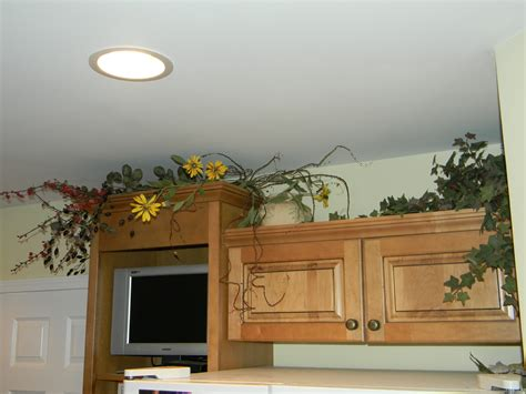 plants above kitchen cabinets decorating above kitchen cabinets before and after