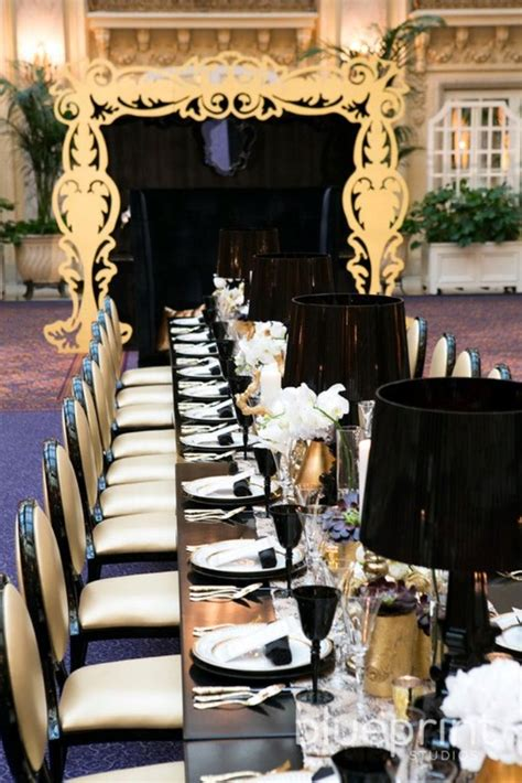 black and gold table gold and black wedding tablescape