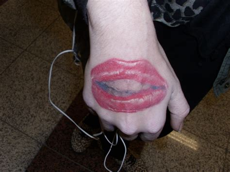 lips tattoo on finger pictures of beauty shhh tattoo on finger