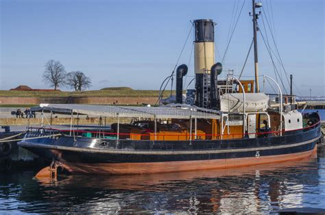 old steam boat old steam boat docked in the harbour editorial photo