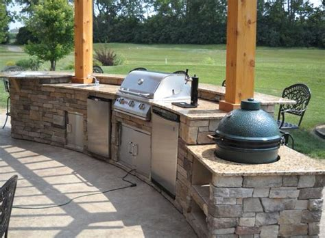 outdoor kitchen with green egg golf course in the background of this beautiful open