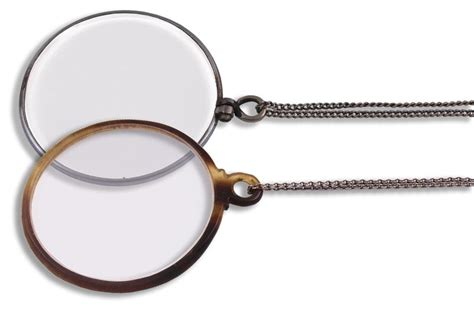 two monocles tortoiseshell rimmed and chrome rimmed in