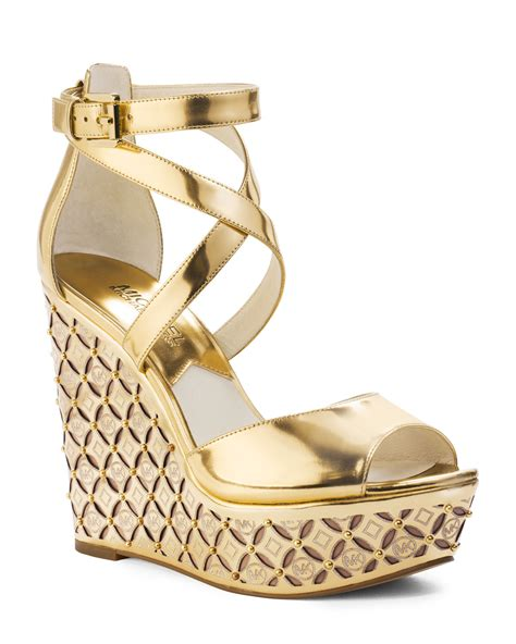 Wedges Gloss Gold michael kors gabriella monogram wedge in metallic lyst
