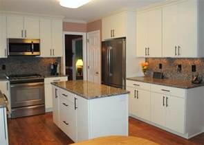 white laminate kitchen cabinets caledonia granite tops and backsplash white quot rohe quot cabinets laminate floors kitchen other