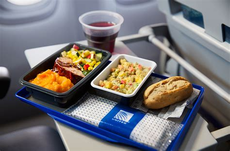 united airlines service free and wine upgraded meals in united airlines international economy class